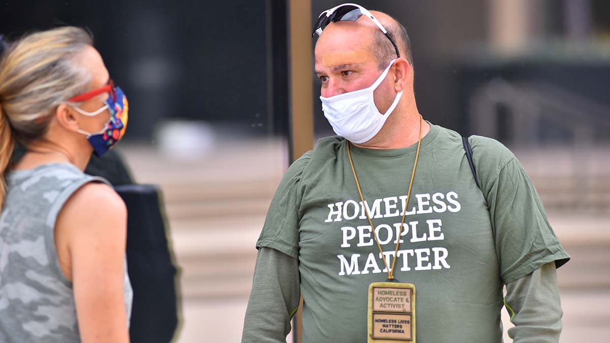 A homeless advocate and activist attends a memorial service for three homeless men killed in a crash near City College.