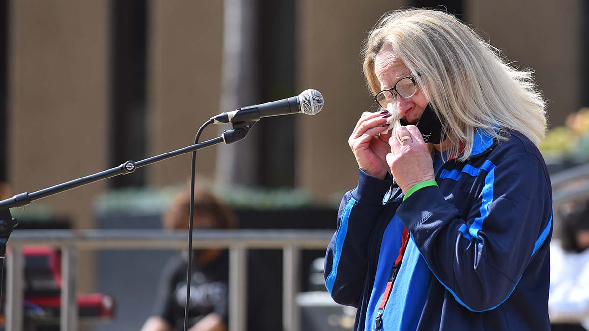 Sherry Kruska tears up after speaking about her brother Walter Jones, one of the three homeless men who was killed March 15 under a bridge. Photo by Chris Stone