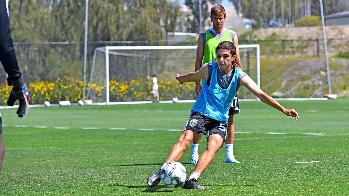 Xavi Gnaulati, 16, participates in a drill as San Diego Loyal player Collin Martin looks on.