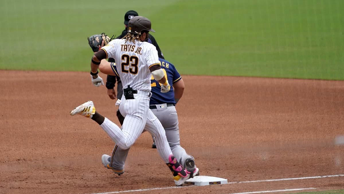 Fernando Tatis Jr. beats the tag at first base.