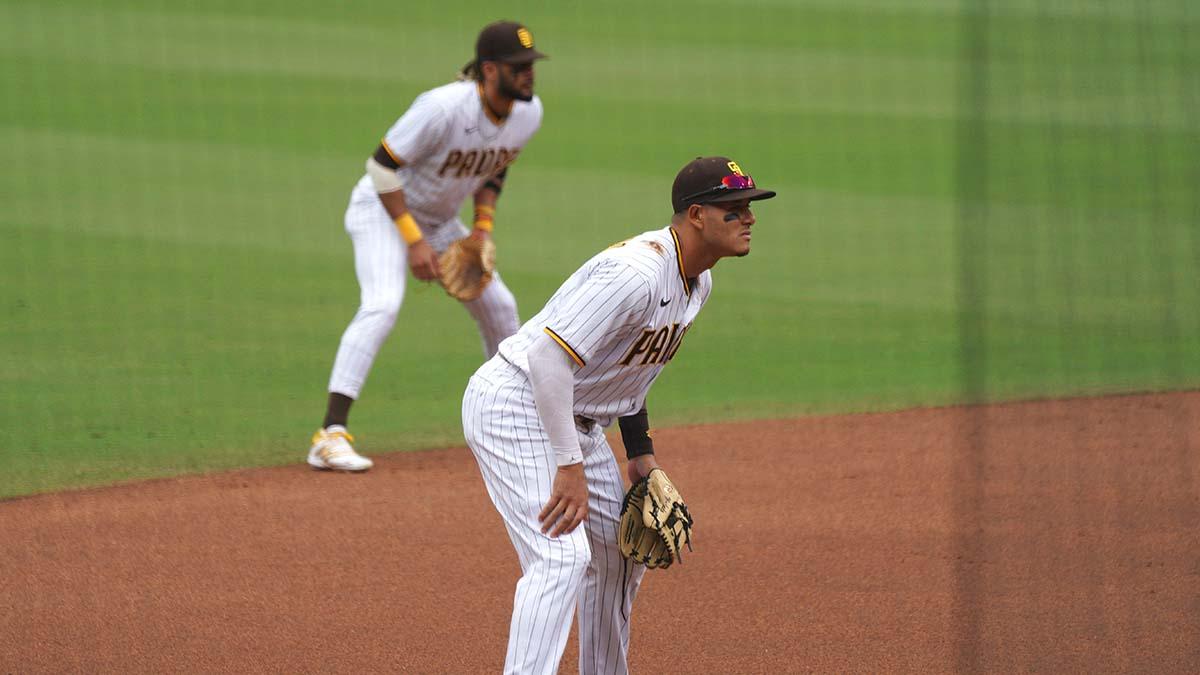 Fernando Tatis Jr. (left) and Manny Machado watch the batter.