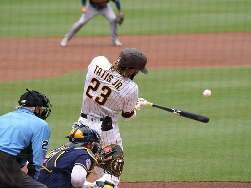 Fernando Tatis Jr. takes a swing.