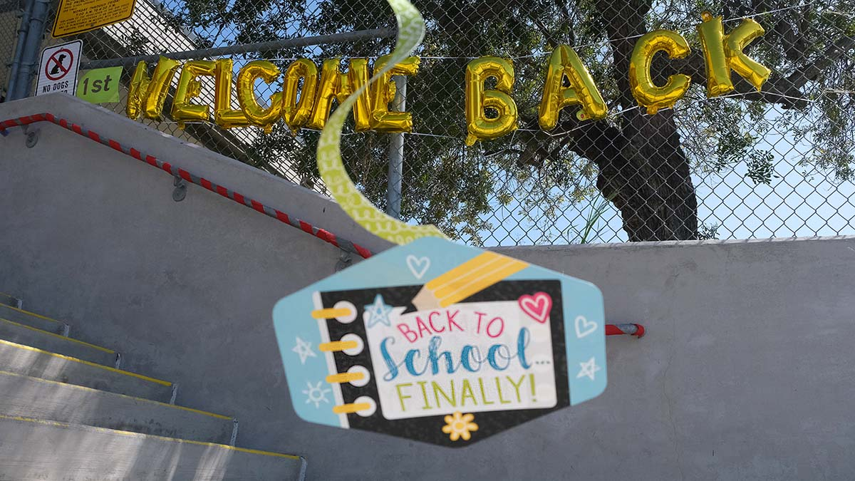 Children at the Benchley Weinberger Elementary School in the San Diego Unified School District were greeted with signs. Photo by Chris Stone