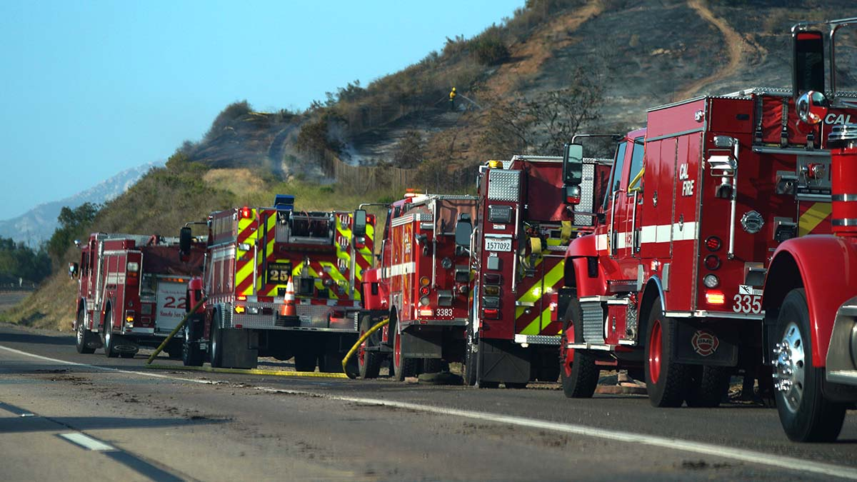 At least a dozen fire engines responded to brush blaze on slope between Las Coches Road and Greenfield Drive off Interstate 8.