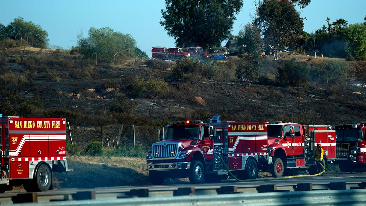 Fire engines lines the base of slope on eastbound Interstate 8 in the Granite Hills are