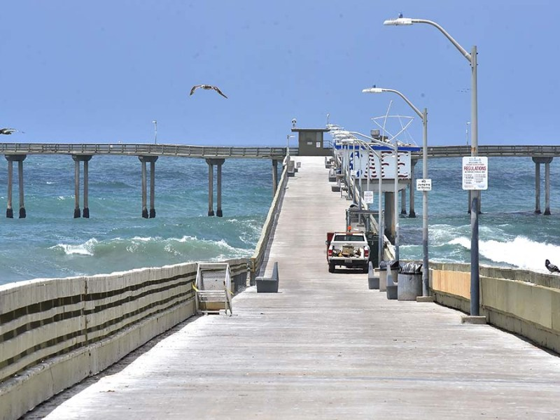 The railings on the Ocean Beach Pier have been repaired in anticipation of its reopening after a January storm damaged it. Photo by Chris Stone
