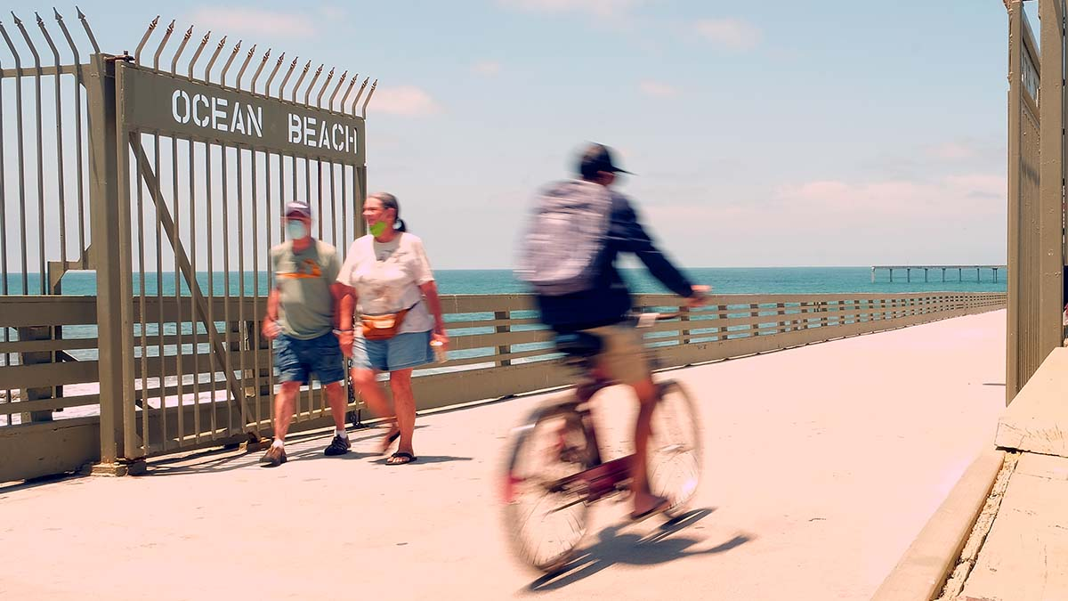 Residents and tourists were eager to get onto the Ocean Beach Pier when it reopened Friday.