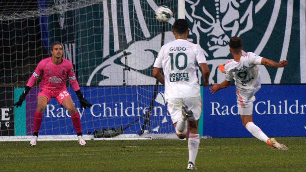 Ben Spencer (right) attacks the goal but misses on the shot. Photo by Chris Stone