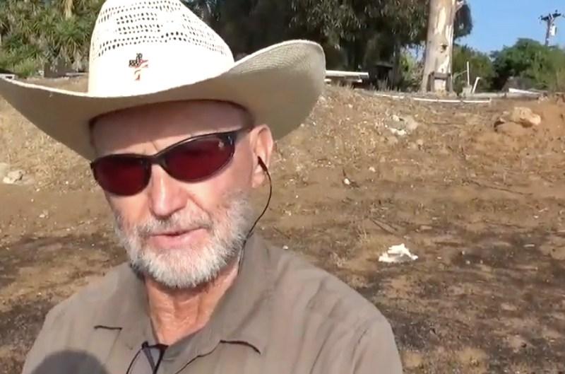 David Burton overlooking charred acreage beneath his Granite Hills area home
