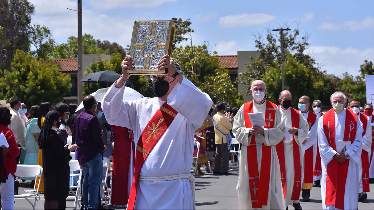 Dozens of priests attended the outside multicultural Mass in Mira Mesa. Photo by Chris Stone