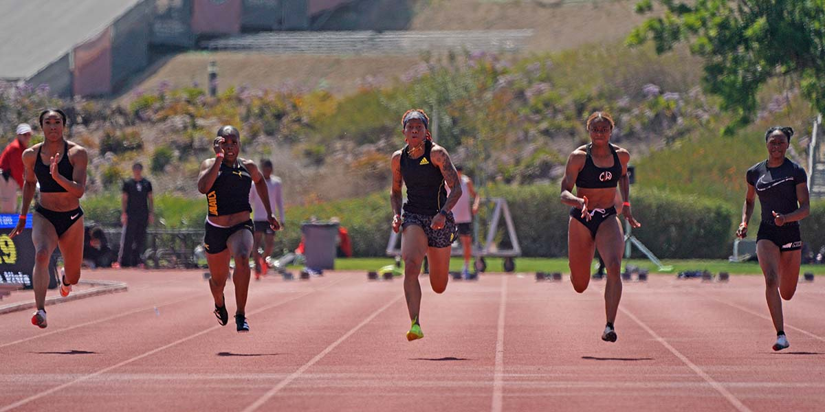 Women compete in the 100m final at the Chula Vista High Performance #4. Photo by Chris Stone