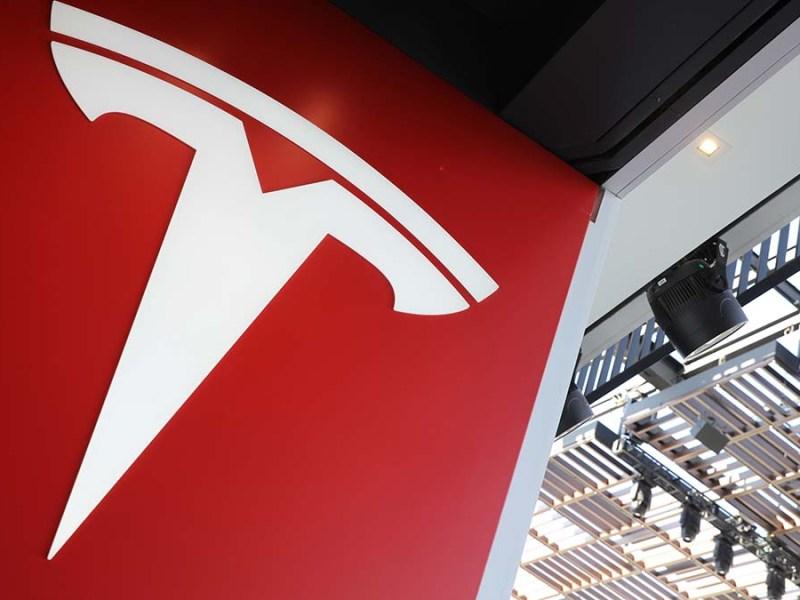 A Tesla logo is seen in Los Angeles.