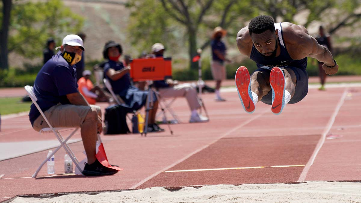 Ifeanyichukwu Otuonye of Turks & Caicos sails in the long jump. Photo by Chris Stone