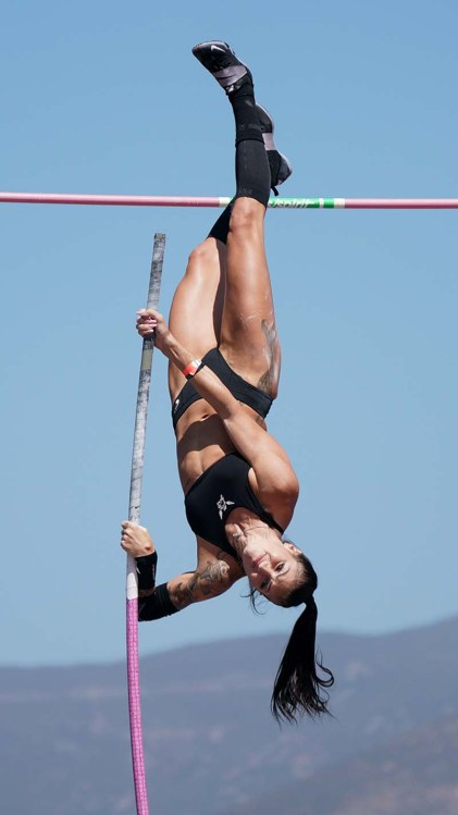 Canadian Anicka Newell stretches above the bar. Photo by Chris Stone