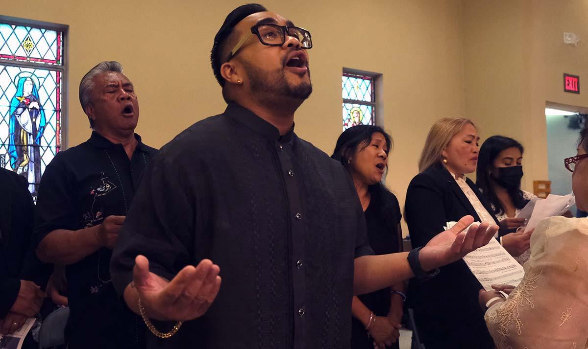 St. Rita Church's choir sings hymn chosen by Fr. Joe Carroll for his own funeral.