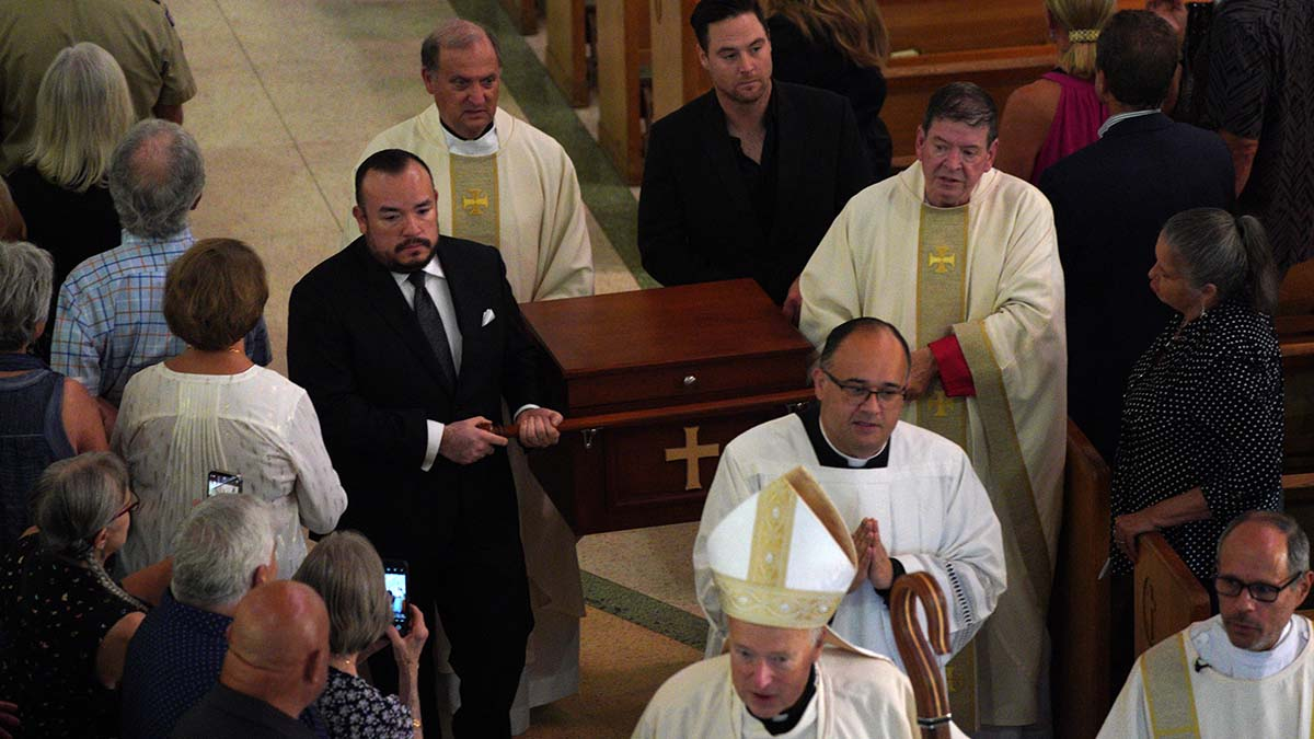 Fr. Joe Carroll's remains are carried out of St. Rita Catholic Church.