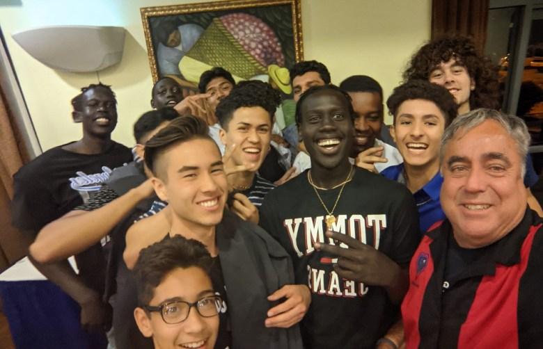 Enrique Morones with Orange Glen High School team