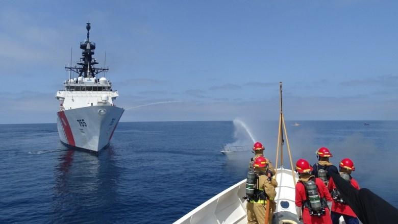 Coast Guard battles boat fire