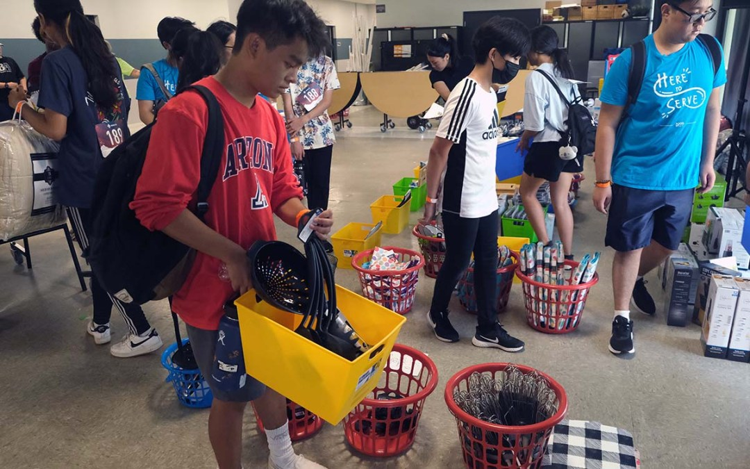 Joshua Le of Wesley United Methodist prepares a welcome home basket for transitioning foster youth. Photo by Chris Stone