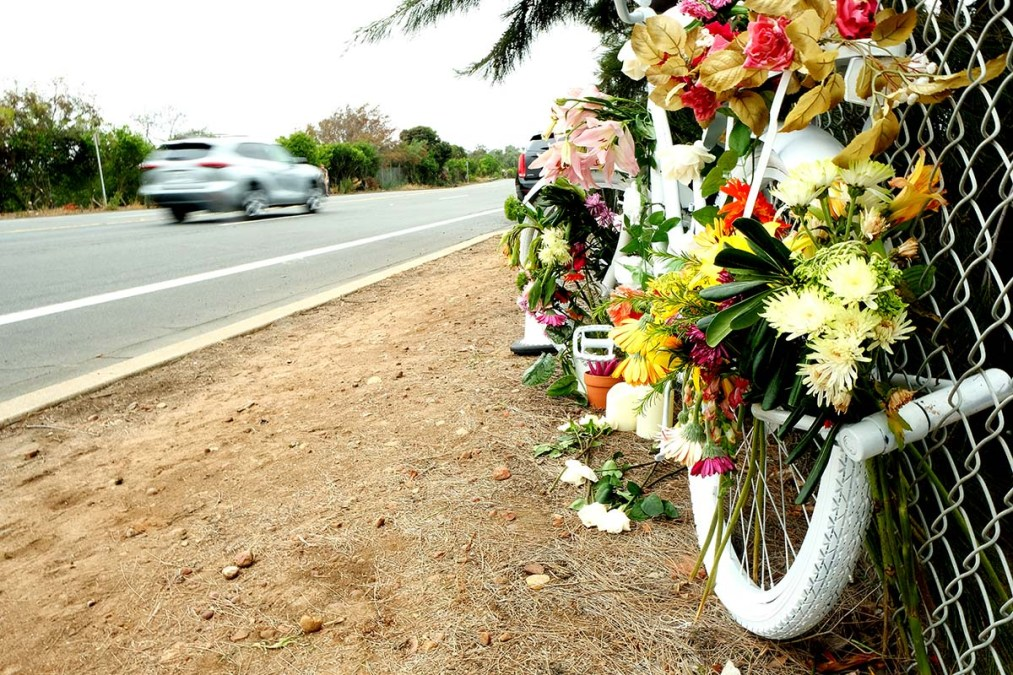 A memorial on the northbound side of Pershing Drive honors Laura Shinn. Photo by Chris Stone