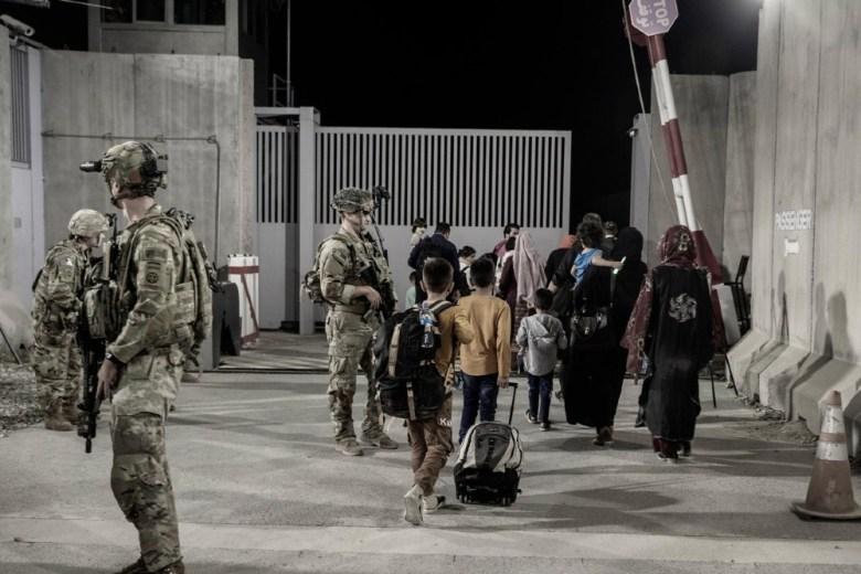 Soldiers escort evacuees