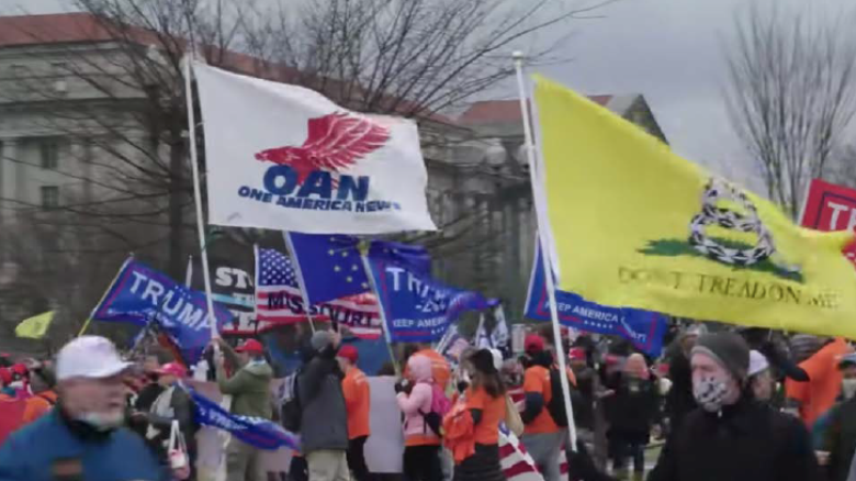 An OAN flag was photographed outside U.S. Capitol during Jan. 6 insurrection.