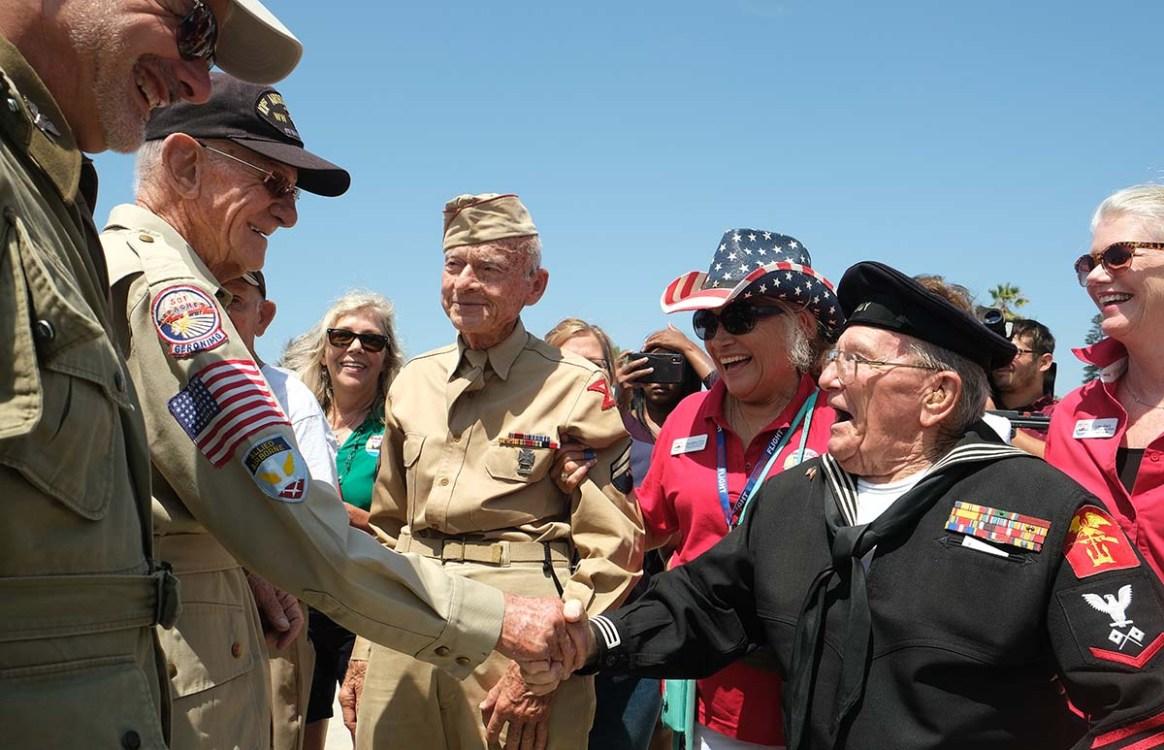 WWII veteran Gil Nadeau (right) congratulates Tom Rice on his successful jump in Coronado. Photo by Chris Stone
