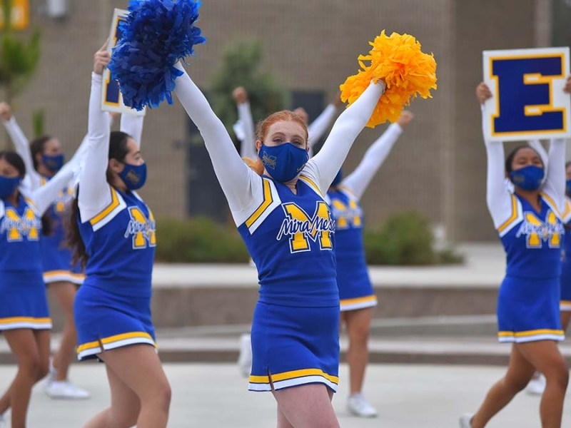 Mira Mesa High School cheerleaders welcome students back to class. Photo by Chris Stone