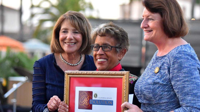Former U.S. Rep Susan Davis (left) and California's Senate President pro Tempore Toni Atkins (right) present Constance Carroll with a proclamation. Photo by Chris Stone