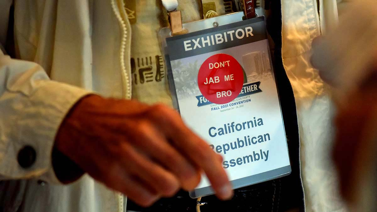 Stickers at state GOP convention poke fun at vaccination.