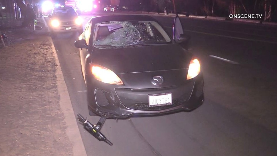 Damaged car and scooter