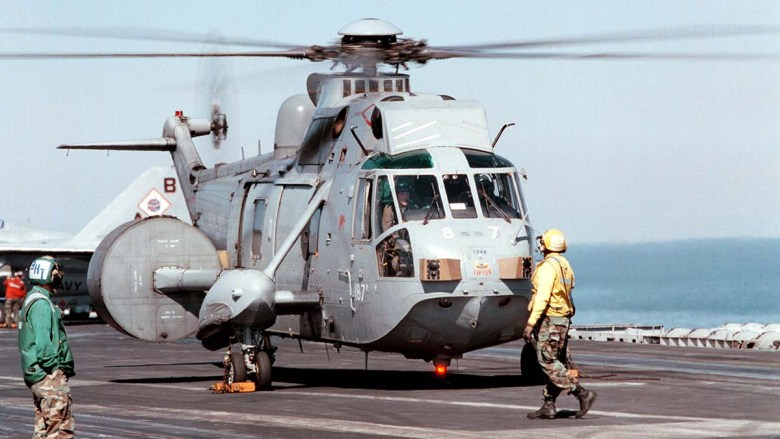 A Sea King from British Royal Navy Helicopter Squadron 849 — the kind that collided in 2003 — prepares to lift from the deck of the U.S. Navy carrier USS George Washington in the Persian Gulf