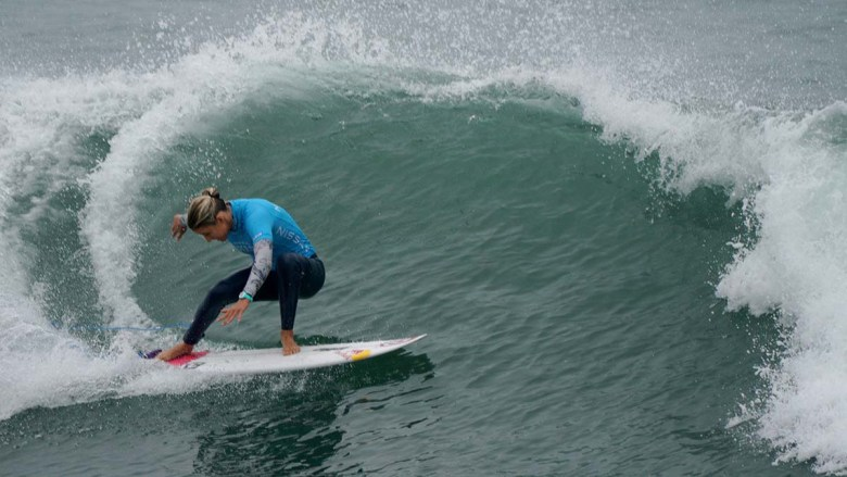 Molly Picklum makes a graceful turn during the fourth round of the Super Girl Surf Pro. Photo by Chris Stone