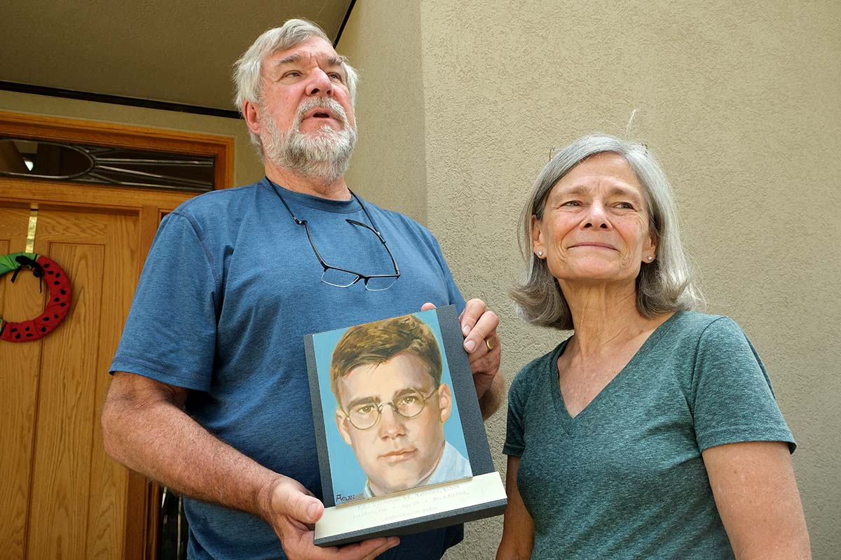"""John and Marilyn Adams display portrait of Tom for the """"Faces of the Fallen"""" exhibition at Arlington National Cemetery."""