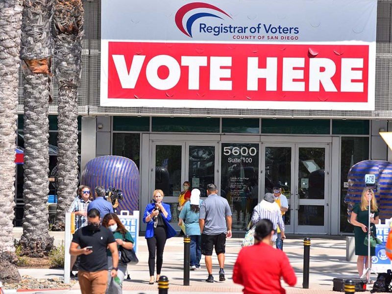A steady stream of voters turned in their ballots at the San Diego County Registrar of Voters. Photo by Chris Stone