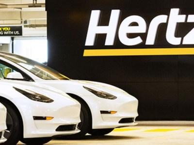 Tesla Model 3 sedans outside Hertz office