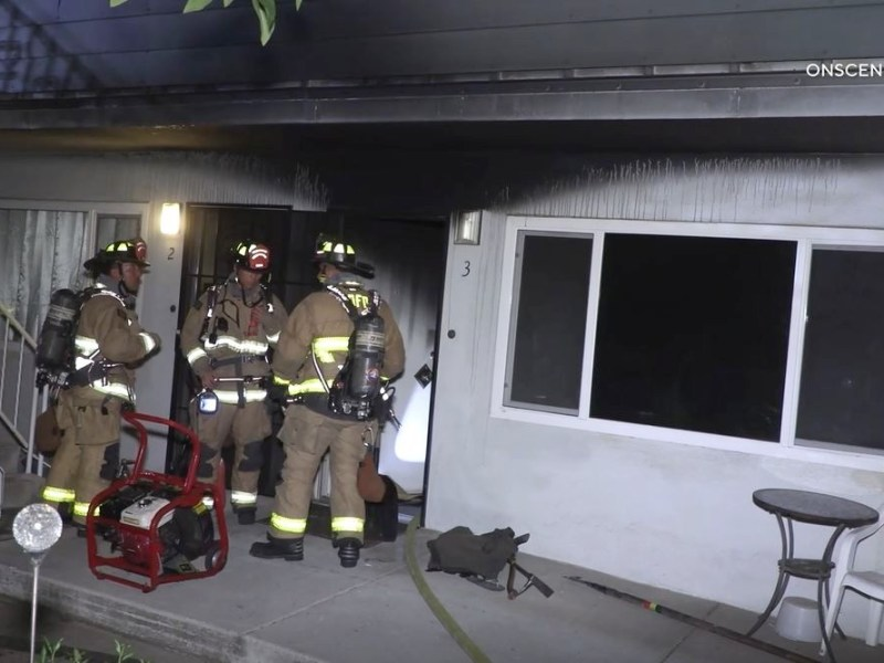 Firefighters at burned unit