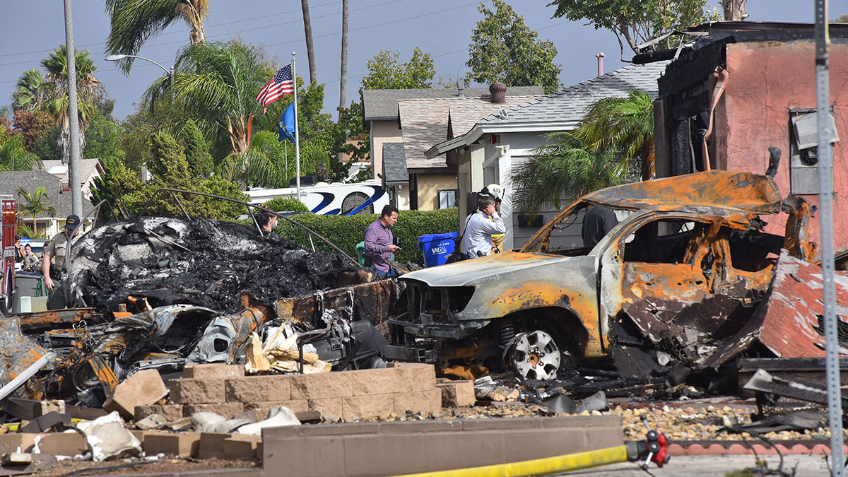 FAA officials arrive to inspect the crash site. Photo by Chris Stone