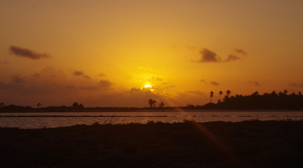The sun goes down off of Rangiroa, French Polynesia.