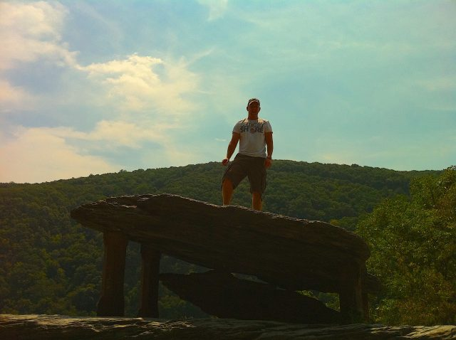 Standing on a rock overlooking the Potomac
