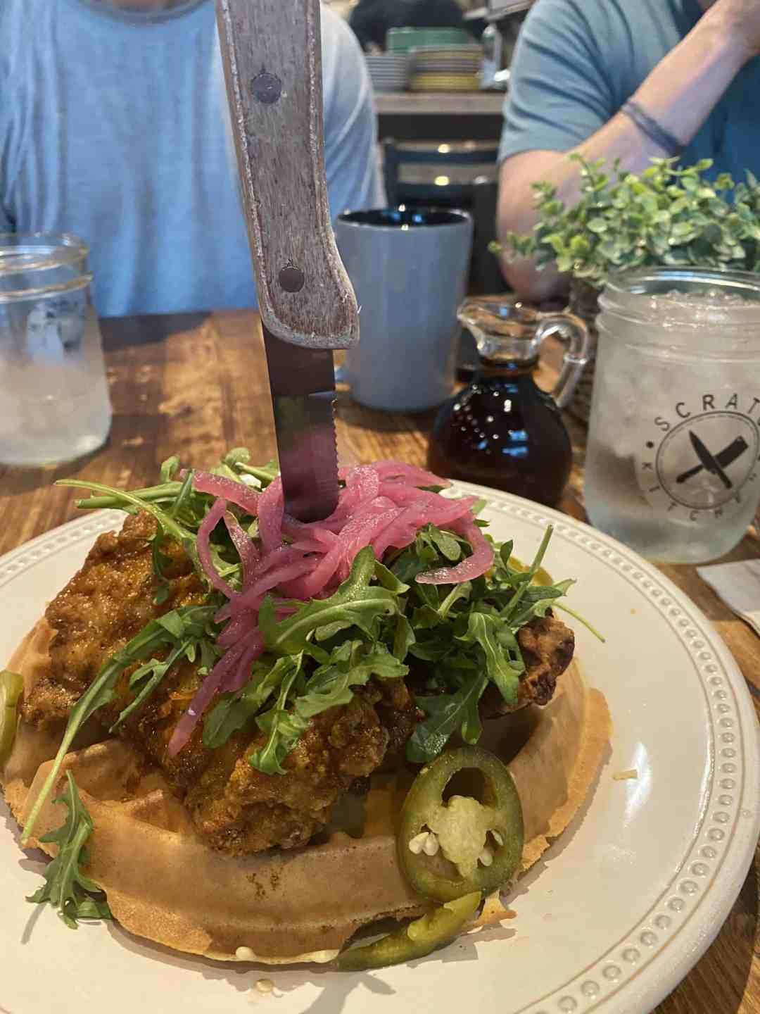 Spicy fried chicken breast on top of a waffle in Honolulu