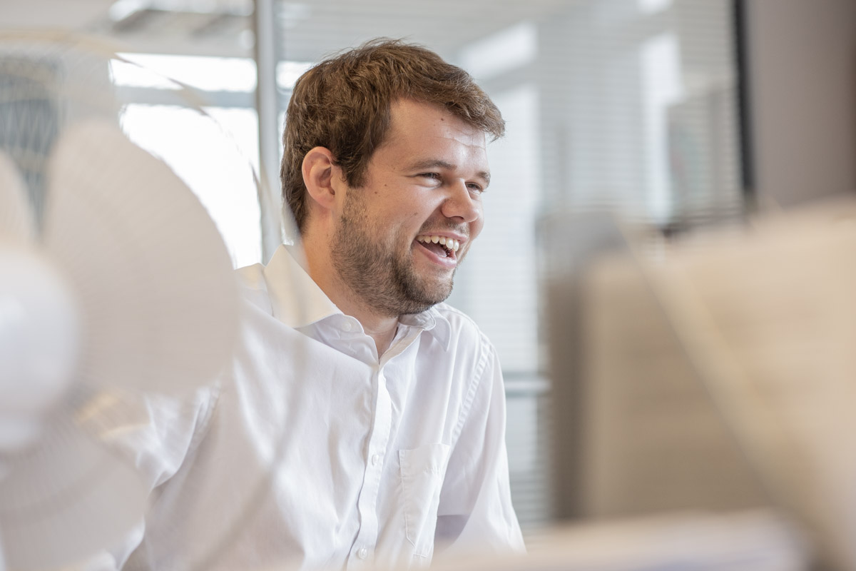 Laughing office worker at his desk.