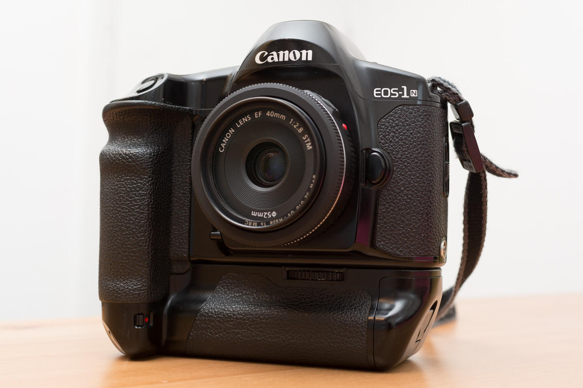 Canon EOS-1N with speed grip and 40mm f/2.8 pancake lens attached.