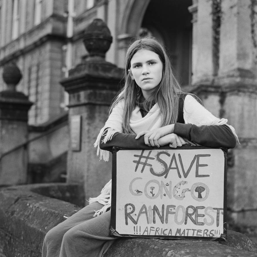 """Portrait of Grace Maddrell (14) with placard which reads """"#savecongorainforest Africa matters too!"""""""