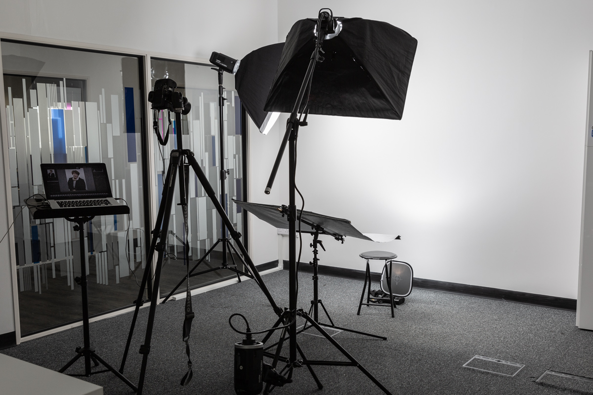 Business portrait mobile studio flash equipment set up in an office space.
