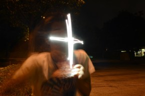 David makes a cross with an LED light