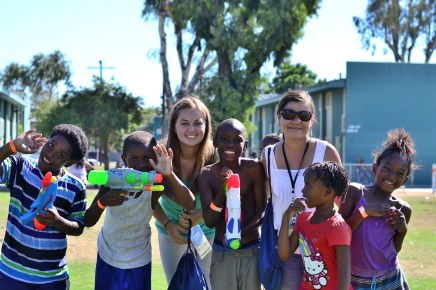 People from our group meeting some kids from Watts with squirt guns.