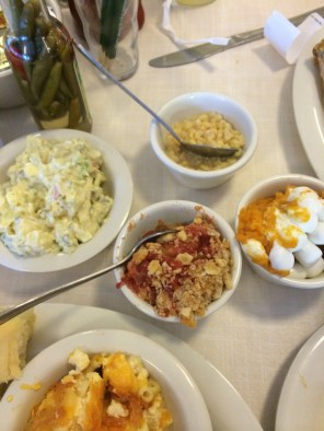 Mary mac's potato salad, tomato pie, sweet potato souffle, and creamed corn side dishes.