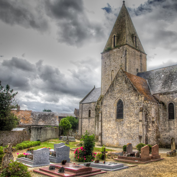You can't help but notice all the churches as you travel through the French countryside. Every village or town has one. This was taken between the rain bursts we drove through while leaving Normandy. The skies had been dark all afternoon and the rain came and went until we hit Paris, when the bottom fell out. Even on a rainy day, it still has an old world charm.<br />