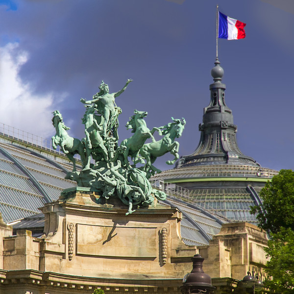 Atop the two corner entrances to the Grand Palais you will find a Quadriga, or a chariot drawn by four horses abreast. They are the the work of French sculptor Georges Récipon, created around 1900. Each entrance is concave, with the quadriga rising a hundred feet above street level. This copper quadriga on the Seine side, Harmony Triumphing Over Discord, weighs 12 tons, yet seems to defy the law of gravity as the horses leap into the air. Photo by Tim Stanley Photography.